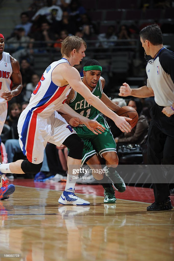 Courtney Lee #11 of the Boston Celtics dribbles the ball up court against Kyle Singler #25 of the Detroit Pistons on November 18, 2012 at The Palace of Auburn Hills in Auburn Hills, Michigan.