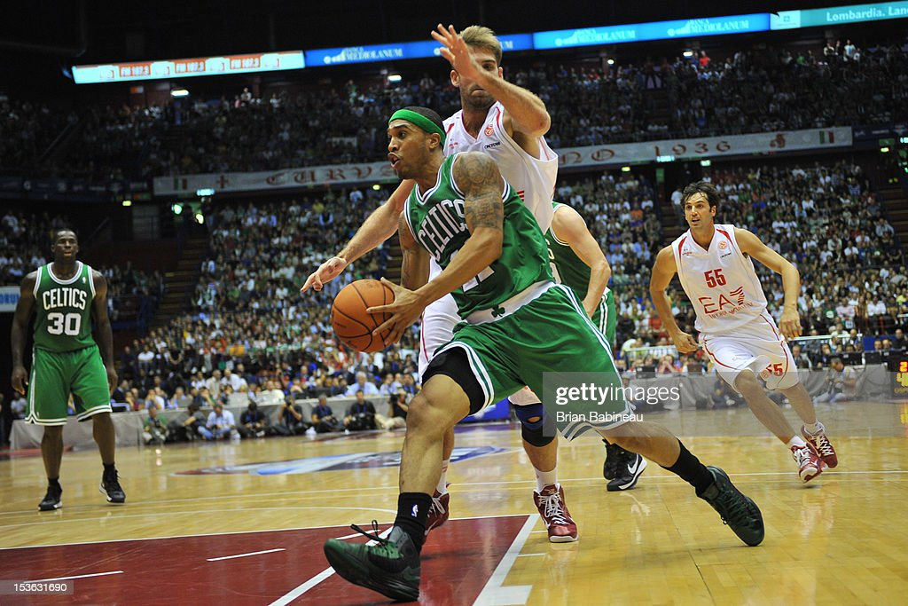 Courtney Lee #11 of the Boston Celtics drives against David Chiotti #13 of the EA7 Emporio Armani Milano during the game between the Boston Celtics and the EA7 Emporio Armani Milano on October 7, 2012 at Mediolanum Forum in Milan, Italy.
