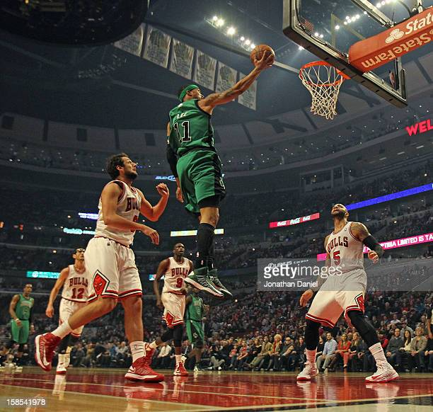 Courtney Lee of the Boston Celtics goes up betrween Marco Belinelli and Carlos Boozer of the Chicago Bulls at the United Center on December 18 2012...