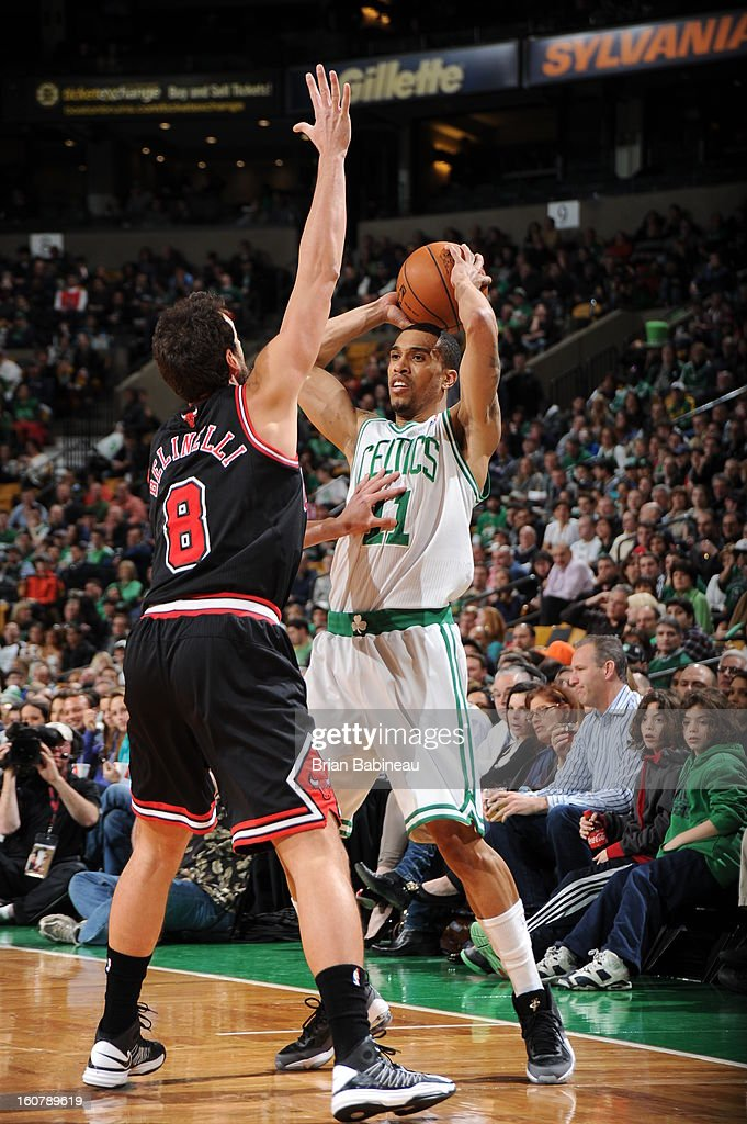 Courtney Lee #11 of the Boston Celtics looks to pass the ball against Marco Belinelli #8 of the Chicago Bulls on January 18, 2013 at the TD Garden in Boston, Massachusetts.