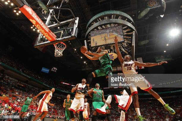 Courtney Lee of the Boston Celtics shoots a layup against Mario Chalmers of the Miami Heat on April 12 2013 at American Airlines Arena in Miami...