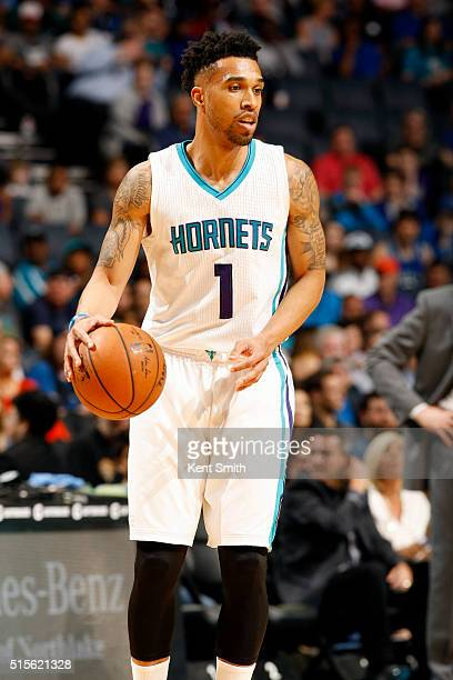 Courtney Lee of the Charlotte Hornets handles the ball during the game against the Dallas Mavericks on March 14 2016 at Time Warner Cable Arena in...