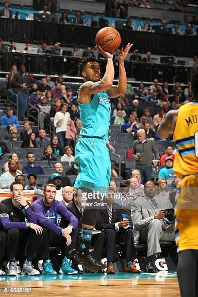 Courtney Lee of the Charlotte Hornets shoots the ball against the Denver Nuggets on March 19 2016 at Time Warner Cable Arena in Charlotte North...