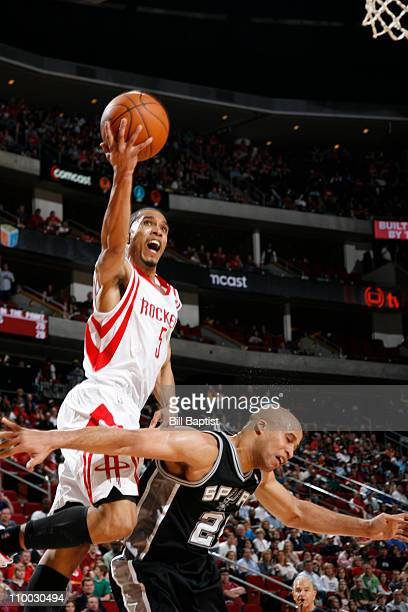 Courtney Lee of the Houston Rockets shoots the ball over Richard Jefferson of the San Antonio Spurs on March 12 2011 at the Toyota Center in Houston...