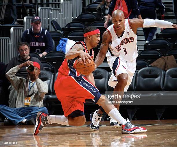 Courtney Lee of the New Jersey Nets drives against Maurice Evans of the Atlanta Hawks on December 13 2009 at Philips Arena in Atlanta Georgia NOTE TO...
