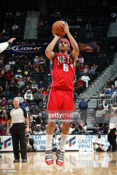 Courtney Lee of the New Jersey Nets shoots a jump shot during the game against the Atlanta Hawks at Philips Arena on December 13 2009 in Atlanta...