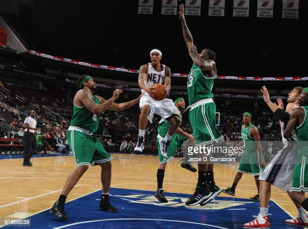 Courtney Lee of the New Jersey Nets shoots against Rasheed Wallace and Kendrick Perkins of the Boston Celtics during the preseason game on October 13...