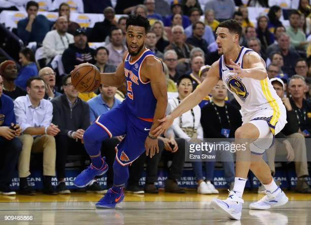 Courtney Lee of the New York Knicks drives on Klay Thompson of the Golden State Warriors at ORACLE Arena on January 23 2018 in Oakland California...