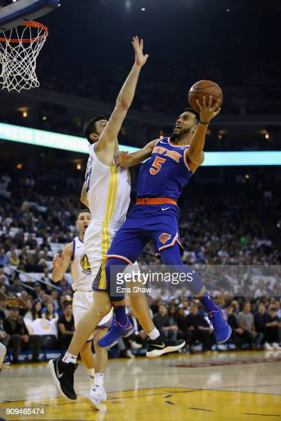 Courtney Lee of the New York Knicks goes up for a shot against Zaza Pachulia of the Golden State Warriors at ORACLE Arena on January 23 2018 in...