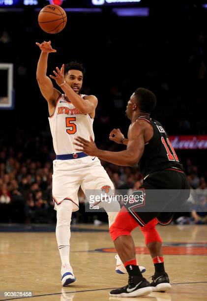 Courtney Lee of the New York Knicks passes the ball sa David Nwaba of the Chicago Bulls defends at Madison Square Garden on January 10 2018 in New...