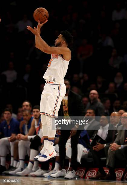 Courtney Lee of the New York Knicks shoots a three point shot in the second half against the San Antonio Spurs at Madison Square Garden on January 02...