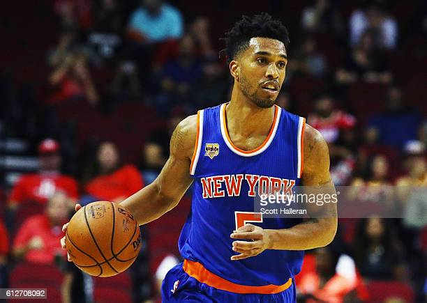Courtney Lee of the New York Knicks takes the basketball up the court during their game against the Houston Rockets at the Toyota Center on October 4...