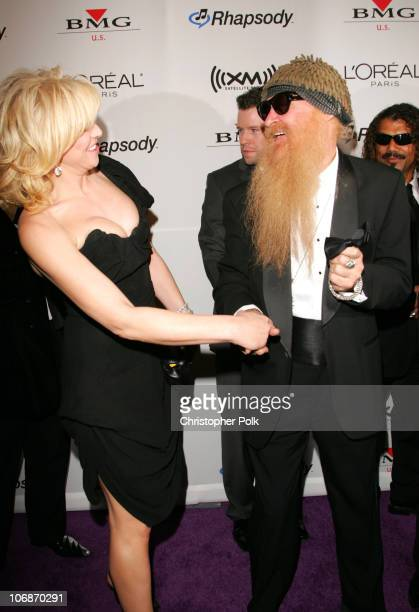 Courtney Love and Billy Gibbons of ZZ Top during 2006 Clive Davis PreGRAMMY Awards Party Arrivals at Beverly Hilton Hotel in Beverly Hills California...