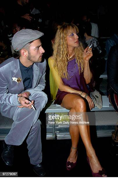 Courtney Love and boyfriend Jason Preston at the Marc Jacobs Fashion Show held in the Lexington Ave Armory he's wearing the dead mouse brooch