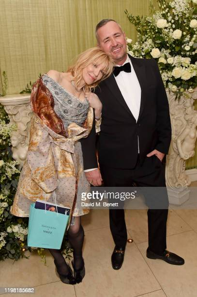 Courtney Love and Fat Tony attend the British Vogue and Tiffany & Co. Fashion and Film Party at Annabel's on February 2, 2020 in London, England.