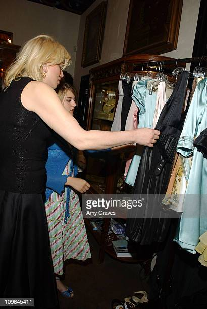 Courtney Love and Frances Bean Cobain looking at Claire LaFaye collection
