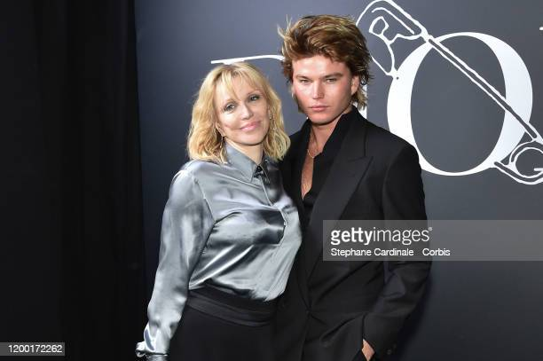 Courtney Love and Jordan Barrett attend the Dior Homme Menswear Fall/Winter 20202021 show as part of Paris Fashion Week on January 17 2020 in Paris...