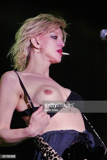 Courtney Love exposes herself while performing on stage during Music Midtown May 2 2004 in Atlanta Georgia