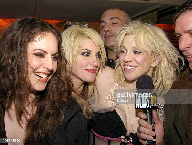 Courtney Love Kurt Loder and members of her band