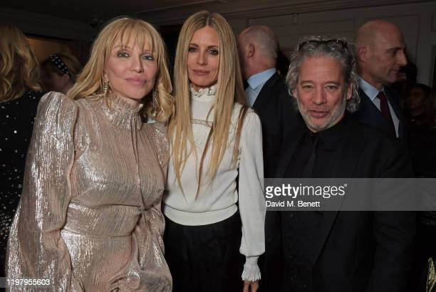 Courtney Love Laura Bailey and Dexter Fletcher attend the Charles Finch CHANEL PreBAFTA Party at 5 Hertford Street on February 1 2020 in London...