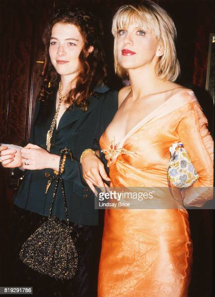 Courtney Love links arms with Hole bandmate Melissa Auf der Maur at ACLU Torch of Liberty Dinner at the Century Plaza Hotel Los Angeles on May 21...