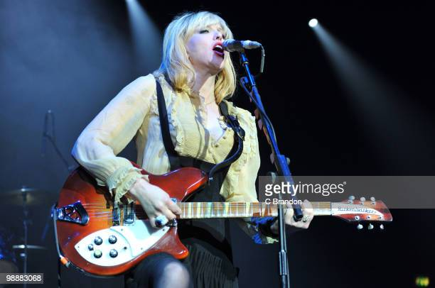 Courtney Love of Hole performs on stage at Brixton Academy on May 5 2010 in London England She plays a Rickenbacker 360 guitar