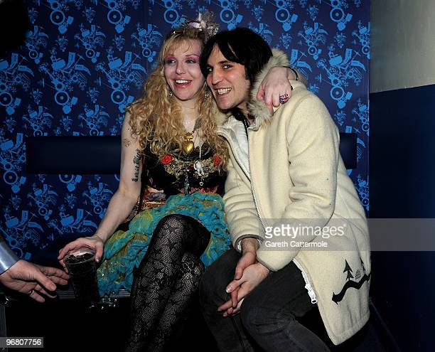 Courtney Love poses with Noel Fielding after her gig with Hole at the NME Shockwaves awards Show at Shepherd's Bush Empire on February 17 2010 in...