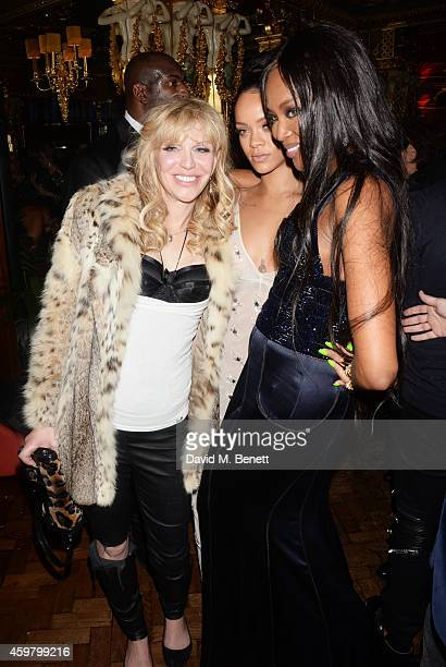 Courtney Love Rihanna and Naomi Campbell attend a party in celebration of Edward Enninful in The Oscar Wilde Bar Hotel Cafe Royal on December 1 2014...