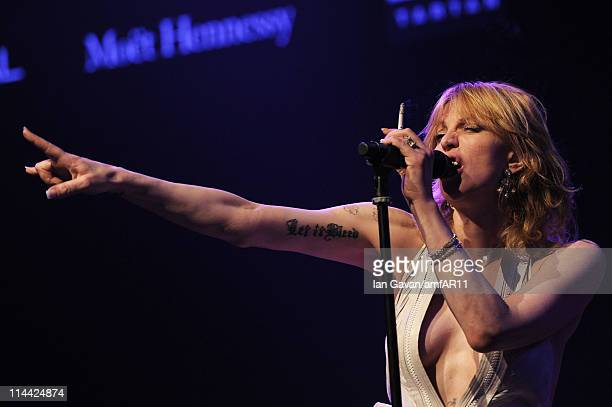 Courtney Love sings during amfAR's Cinema Against AIDS Gala during the 64th Annual Cannes Film Festival at Hotel Du Cap on May 19 2011 in Antibes...