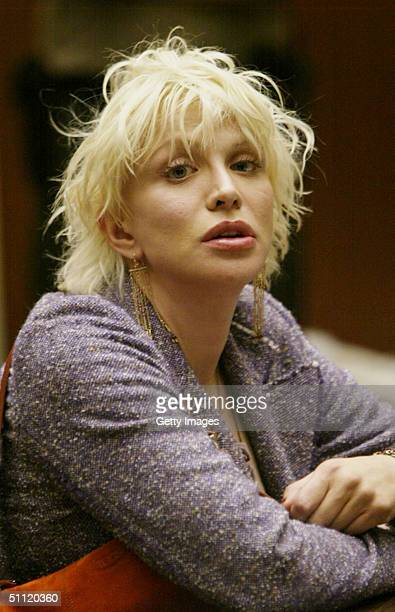 Courtney Love sits at Los Angeles Superior Court waiting to be sentenced in the first of two hearings the singer-actress faces this week in separate...