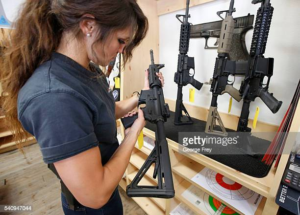 Courtney Manwaring looks over an AR-15 semi-automatic gun at Action Target on June 17, 2016 in Springville, Utah. Semi-automatics are in the news...