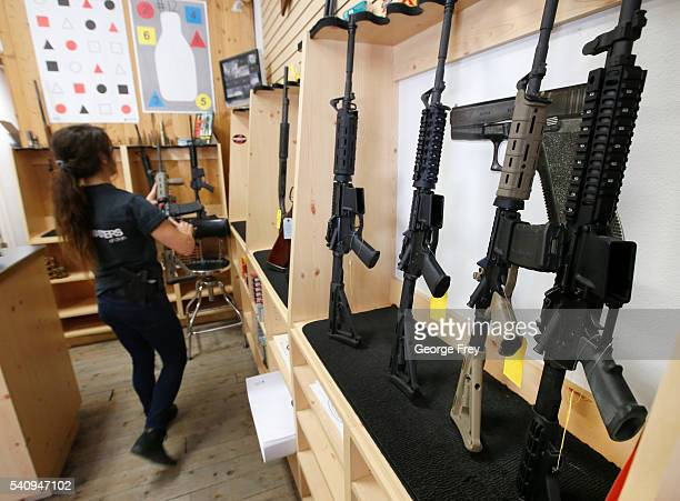 Courtney Manwaring puts away an AR-15 semi-automatic gun at Action Target on June 17, 2016 in Springville, Utah. Semi-automatics are in the news...