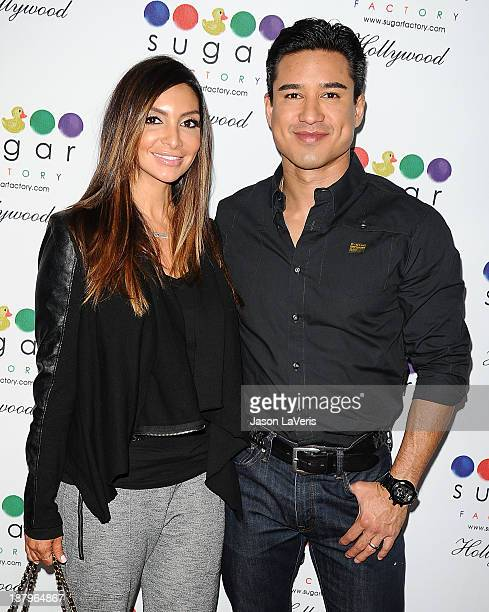 Courtney Mazza and Mario Lopez attend the grand opening of Sugar Factory Hollywood on November 13 2013 in Hollywood California