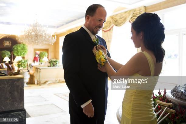 Courtney McAlpin pins a corsage on her father's lapel on May 16 2008 in Colorado Springs Colorado The Father Daughter Purity Ball founded in 1998 by...