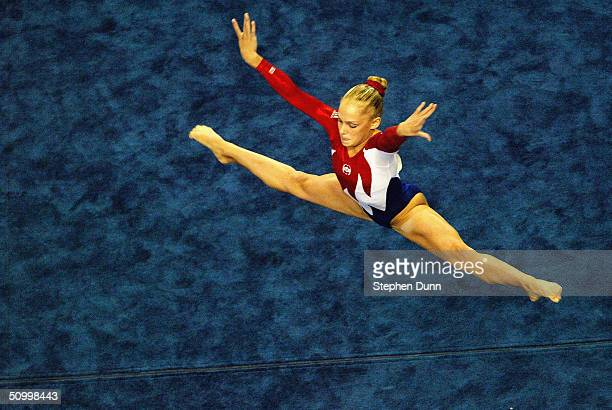Courtney McCool competes in the floor exercise during the Women's preliminaries of the US Gymnastics Olympic Team Trials on June 25 2004 at The...