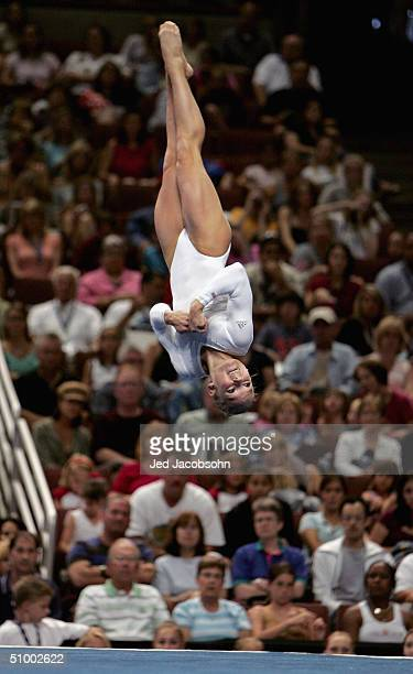 Courtney McCool competes in the floor exercises during the Women's finals of the U.S. Gymnastics Olympic Team Trials on June 27, 2004 at The...