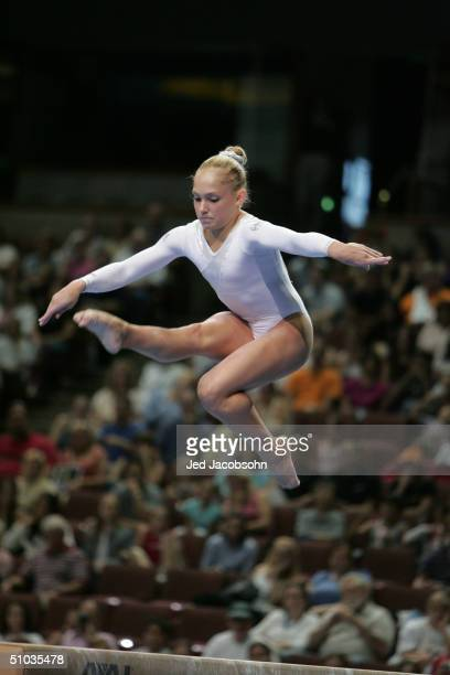 Courtney McCool competes on the balance beam during the Women's finals of the U.S. Gymnastics Olympic Team Trials on June 27, 2004 at The Arrowhead...