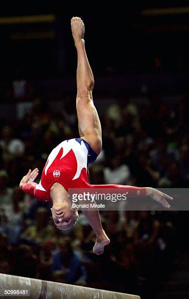 Courtney McCool competes on the balance beam during the Women's preliminaries of the U.S. Gymnastics Olympic Team Trials on June 25, 2004 at The...