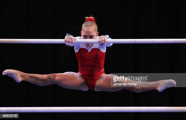 Courtney McCool competes on the uneven bars during the 2004 U.S. Gymnastics Championships on June 5, 2004 at the Gaylord Entertainment Center in...