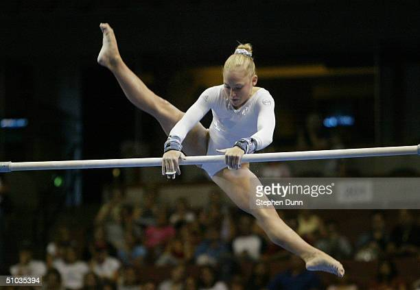Courtney McCool competes on the uneven bars during the Women's finals of the U.S. Gymnastics Olympic Team Trials on June 27, 2004 at The Arrowhead...
