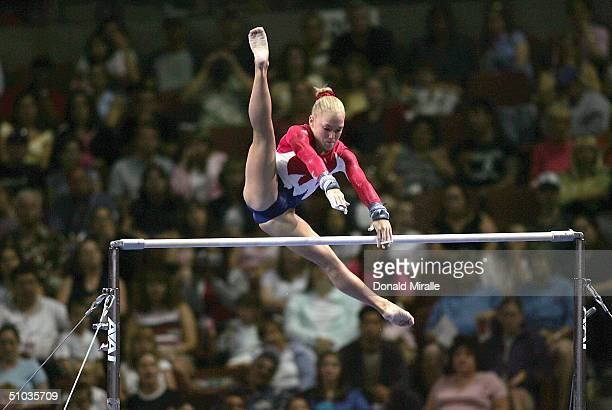 Courtney McCool competes on the uneven bars during the Women's preliminaries of the U.S. Gymnastics Olympic Team Trials on June 25, 2004 at The...