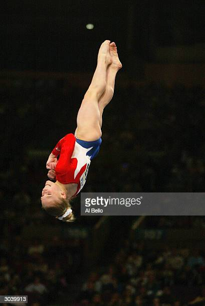 Courtney McCool dismounts during the VISA American Cup on February 28 2004 at Madison Square Garden in New York City New York