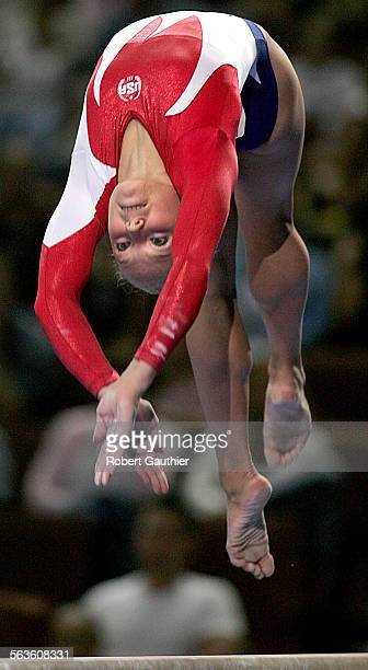 Courtney McCool looks back for the balance beam as she attempts a backflip at the 2004 USA Women's Gymnastics Trials at the Anaheim Pond, Friday,...