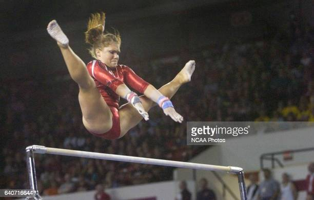 Courtney McCool of the University of Georgia competes on the uneven parallel bars during the Division I Womens Gymnastics Championship held at...
