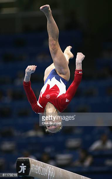 Courtney McCool of the USA competes in the qualification round of the team event at the women's artistic gymnastics competition on August 15, 2004...