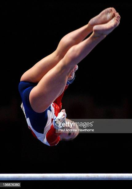 Courtney McCool of the USA competes on the uneven parallel bars during the Visa American Cup February 28 at New York City's Madison Square Garden