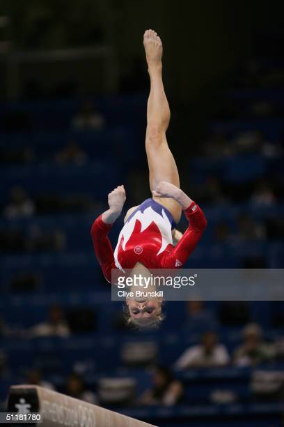 Courtney McCool of the USA performs on the balance beam in the qualification round of the team event at the women's artistic gymnastics competition...