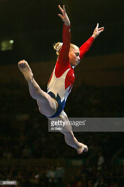 Courtney McCool performs her routine during the VISA American Cup on February 28, 2004 at Madison Square Garden in New York City, New York.