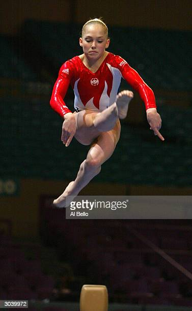 Courtney McCool performs on the balance beam during the VISA American Cup on February 28 2004 at Madison Square Garden in New York City New York