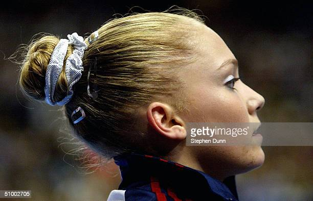 Courtney McCool watches the competition during the Women's finals of the US Gymnastics Olympic Team Trials on June 27 2004 at The Arrowhead Pond of...